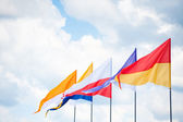 Triangular flags in wind — Stock Photo