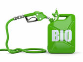 Biofuel. Gas pump nozzle and jerrycan — Stock fotografie