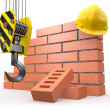 Under construction. Brick wall, crane and hardhat - Stock Photo