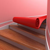 Red carpet on spiral staircases — Stock Photo