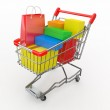 Gift buying. Shopping cart full of boxes — Stock Photo