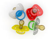 Baby's pacifiers on white isolated background. — Stock Photo