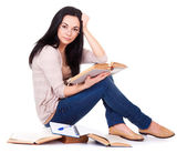 Charming young woman with books — Stock Photo