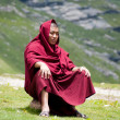 Buddhist monk in mountains — Stock Photo