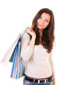 Woman holding shopping bags — Стоковое фото