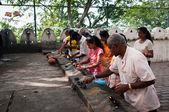 Pilgrimagers ignite coconut oil lamps — Stock Photo