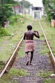 Unidentified asian man on railway lines. — Stock Photo