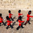 Beefeaters in Tower of London - Stock Photo