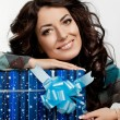 Beautiful fashionable woman with gift box — Stock Photo
