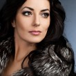 Beautiful fashionable woman with fur — Stock Photo