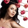 Stock Photo: Beautiful fashionable woman with roses