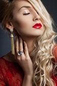 Beautiful fashionable woman in red dress — Stock Photo