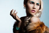 Beautiful fashionable woman with art visage — Stock Photo