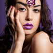 Elegant fashionable woman with violet lips — Stock Photo