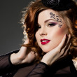 Stock Photo: Fashionable womwith art visage - burlesque