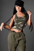Sexy fashionable woman in military uniform — Stock Photo