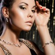 Elegant fashionable woman with golden jewelry — Stock Photo #8587195