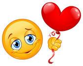 Emoticon with heart balloon — Stock Vector