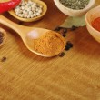 Spices in the spoons — Stock fotografie