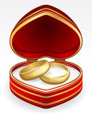 Gold wedding rings with heart-shaped box — Stock Vector