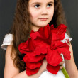 Royalty-Free Stock Photo: Pretty girl with red flower