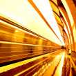 Golden way of moving train in motion — Stock Photo