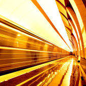 Golden way of moving train in motion — Stockfoto