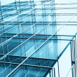 Transparent glass wall with blank placard of skyscraper — Stock Photo