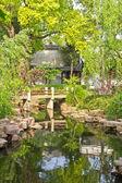 Small bridge in an calm garden — Stock Photo