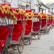 Typical Asian rickshaws - Stock Photo