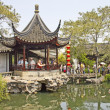 Tourists visit the Lion Grove Garden - Stock Photo