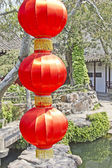 Red lamp in an Asian garden — Стоковое фото