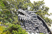Dragon detail on the roof in Yuyuan Garden — Stock Photo