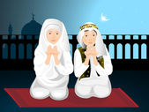 Two cute little muslim kids praying with hands up — Stock Vector