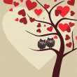Background with couple of owls sitting on branch of Valentine tr — Stockvectorbeeld
