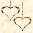 Vector illustration of two hanging heart shapes with copy space — Imagens vectoriais em stock