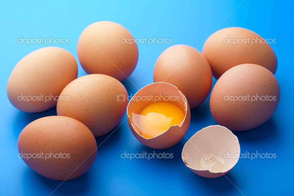 Eggs over blue  Stock Photo #8899983