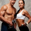 Athletic man and woman - Stockfoto