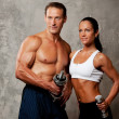 Athletic man and woman — Stock Photo