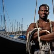 Handsome afro-american sailor against boats. — Stock Photo #10204366