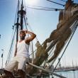 Handsome afro-american sailor against boats. - Stock Photo