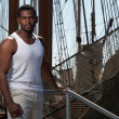 Handsome afro-american sailor against boats. — Stock Photo #10204374
