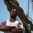 Handsome afro-american sailor against boats. — Stock Photo #10204375