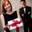 Young couple with a gift box — Stock Photo