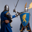 Two medieval knights fighting. - 