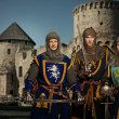 Knights against medieval castle — Stock Photo