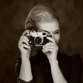 Woman in classic dress with retro camera — Stock Photo