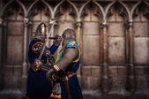 Two knights fighting agaist medieval cathedral wall — Stock Photo