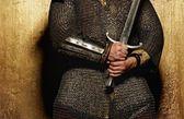 Knight holding sword — Stock Photo