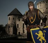 Knight against medieval castle. — Stock Photo